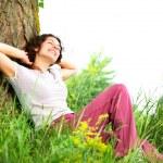 Beautiful Young Woman Relaxing outdoors. Nature — Stock Photo