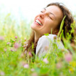 Beautiful Young Woman lying in Meadow of Flowers. Enjoy Nature — Stock Photo
