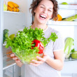 Beautiful Young Woman near the Refrigerator with healthy food — Stock Photo #12801023