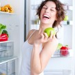 Beautiful Young Woman near the Refrigerator with healthy food — Stock fotografie
