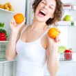 Dieting concept. Laughing Young Woman Eats Fresh Fruit — Stock Photo
