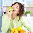 Dieting concept. Healthy Food. Young Woman Eats Fresh Fruit — Stock Photo #12801054