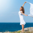 Freedom Concept. Girl with White Scarf standing on the Rock — Stock Photo