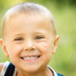 Little Boy Laughing. Kid Over Nature Green Background — Stock Photo