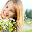 Beautiful Girl Relaxing outdoors. Happy and Smiling — Stock Photo #12801235