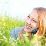 Beautiful Teenage Girl talking on the Phone outdoors — Stock Photo