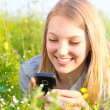 Beautiful Teenage Girl With Cellphone outdoors - Stock Photo