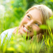 Beautiful Smiling Girl in Green Grass - Stock Photo
