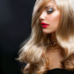 Blond Hair. Beautiful Blond Woman over Black — Stock Photo