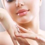 Hands Cream. Female applying moisturizer to her Hand after bath — Stock Photo