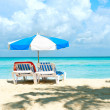 Vacation and Tourism concept. Sunbeds on the beach - Stock Photo