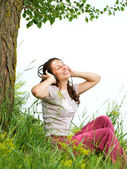 Beautiful Young Woman with Headphones Outdoors. Enjoy Music — Stock Photo