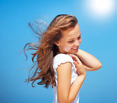 Beautiful Girl over Blue Sky. Healthy Fluttering Hair — Stock Photo