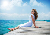 Beautiful Girl on The Pier. Ocean — Stock Photo