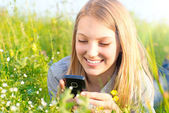 Beautiful Teenage Girl With Cellphone outdoors — Stock Photo