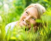 Beautiful Smiling Girl in Green Grass — Stock Photo