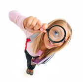 Funny Schoolgirl Looking Through The Magnifying Glass — Stock Photo
