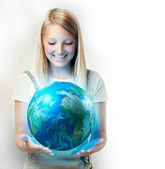 Girl holding the Planet Earth — Stock Photo