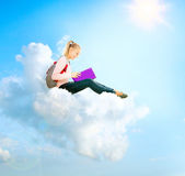 School Girl or Student Sitting on a Cloud and Reading a book — Stock Photo
