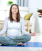 Beautiful Pregnant Woman Doing Yoga at Home — Stock Photo