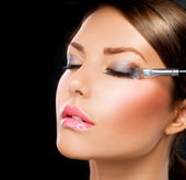 Make-up applying. Eye shadow brush — Stock Photo