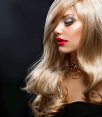 Blond Hair. Beautiful Blond Woman over Black — Stock Photo
