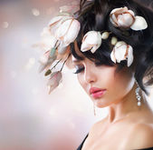 Fashion Brunette Girl with Magnolia Flowers. Hairstyle — Stock Photo