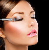 Make-up applying. Eye shadow brush — Stok fotoğraf
