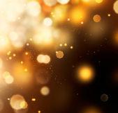 Sfondo dorato bokeh astratta. polvere d'oro sul nero — Foto Stock
