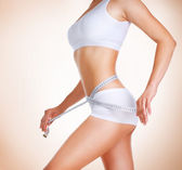 Woman measuring her waistline. Diet. Perfect Slim Body — Stockfoto