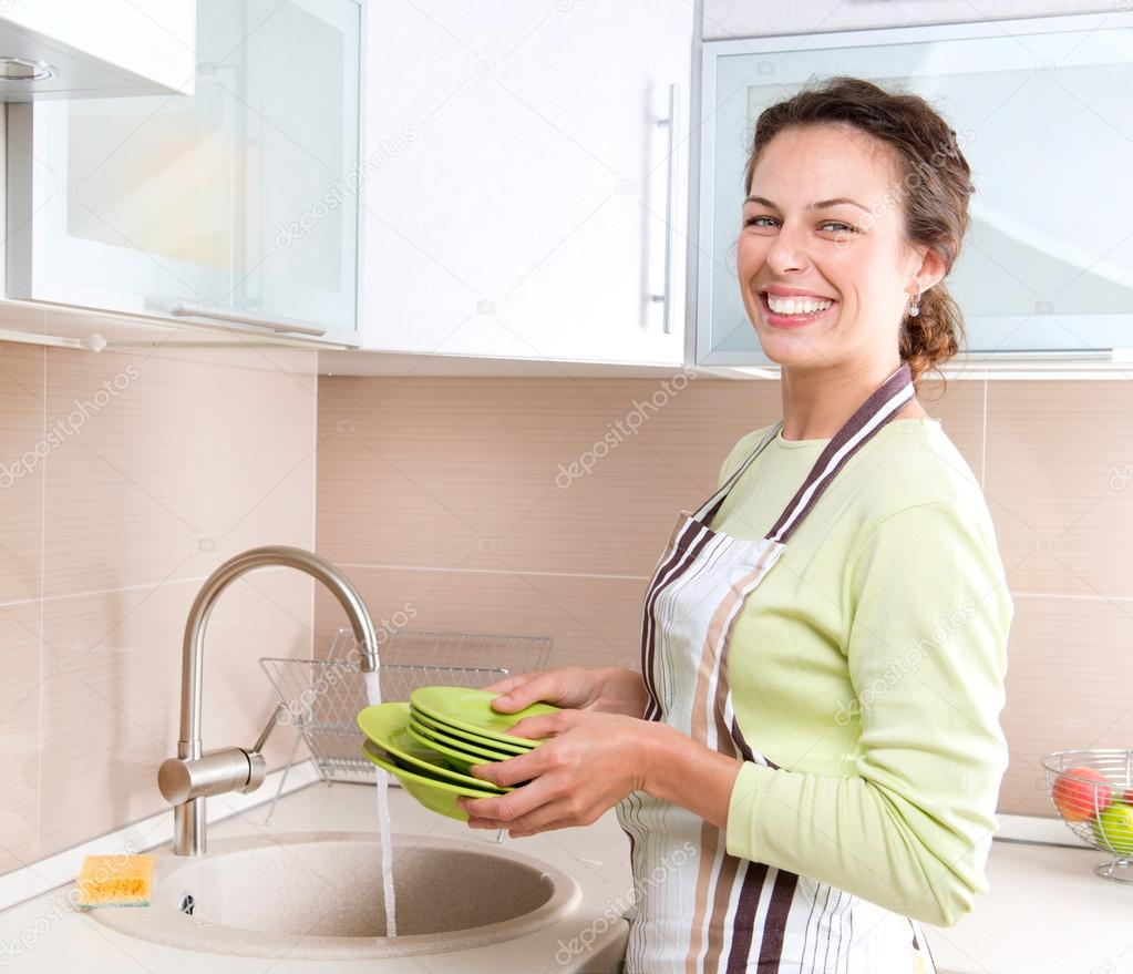 Dishwashing. Happy Young Woman Washing Dishes   Stock Photo #12800556
