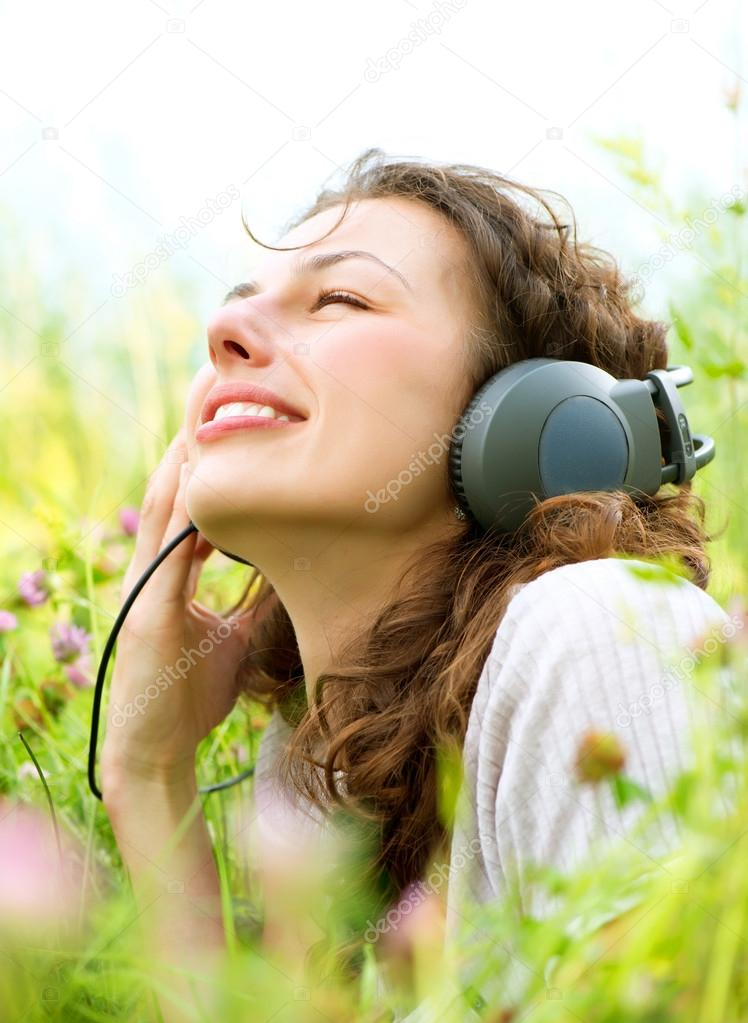 Beautiful Young Woman with Headphones Outdoors. Enjoy Music  — Foto Stock #12800833