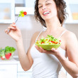 Diet. Healthy Young Woman Eating Vegetable Salad — 图库照片 #14134365