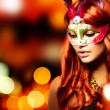 Masquerade. Beautiful Girl in a Carnival mask - Stock Photo