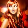 Beautiful Girl With Shiny Red Long Hair over Blinking Background - Stock Photo