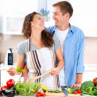 Foto de Stock  : Happy Couple Cooking Together. Dieting. Healthy Food
