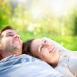 Young Couple Lying on Grass Outdoor — Stock Photo