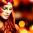 Stock Photo: Masquerade. Beautiful Girl in Carnival mask