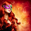 Beautiful Girl in a Carnival mask - Stock Photo