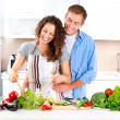 Happy Couple Cooking Together. Dieting. Healthy Food — Stock Photo #14134497
