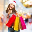 Christmas Shopping. Girl With Bags in Shopping Mall — Stock Photo #14134504