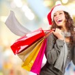 图库照片: Christmas Shopping. Girl With Credit Card In Shopping Mall.Sales