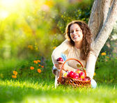 Beautiful Girl Eating Organic Apple in the Orchard — Foto de Stock