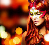 Masquerade. Beautiful Girl in a Carnival mask — Stok fotoğraf