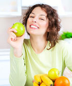 Diet. Happy Young Woman Eating Fresh Fruit — Stock Photo