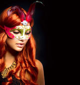 Beautiful Woman in a Carnival mask. Isolated on Black — Stockfoto