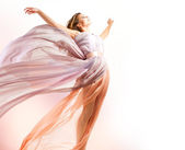 Beautiful Girl in blowing Dress Flying — Stock Photo