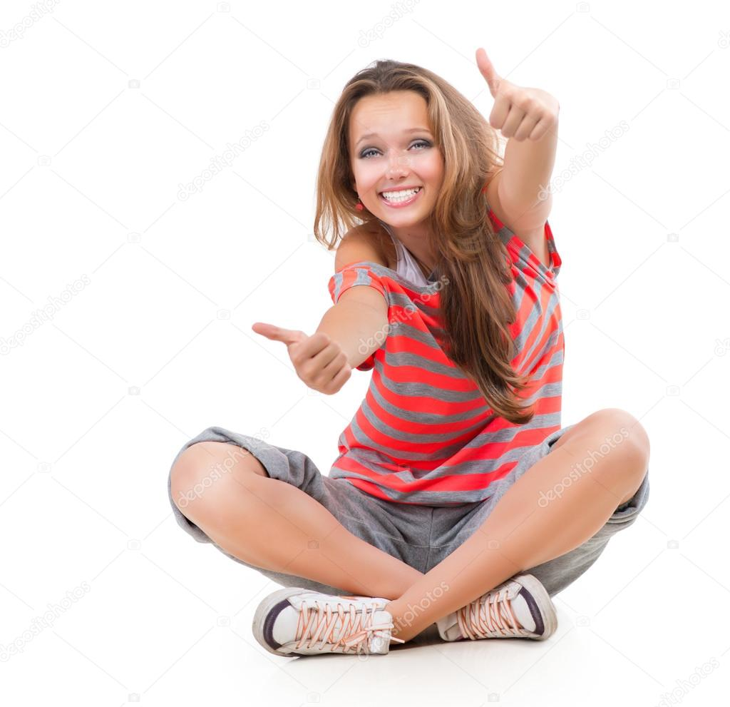 Happy teen girl showing thumbs up isolated one white Tiny girl teen