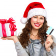 Christmas. Happy Smiling Woman with Gift Box and Credit Card — Stock Photo #16276043