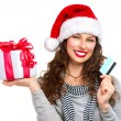 Stock Photo: Christmas. Happy Smiling Woman with Gift Box and Credit Card